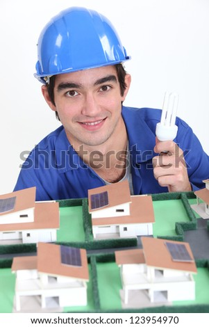 An electrician lighting a miniature. - stock photo