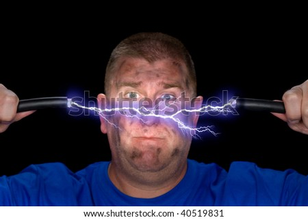 An electrician playes with some live wires, causing an arc of electricity and charring the man's face. - stock photo
