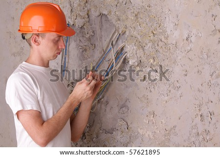 An electrician working in a repair house - stock photo