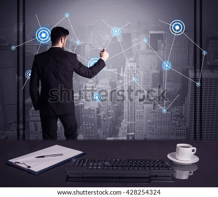 An elegant businessman connecting blue circle dots on urban city scape background concept at an office desk in a conference room - stock photo