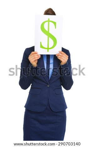 An elegant businesswoman holds a dollar sign up in front of her face. She is wearing a business suit. Above the dollar sign, we see her hair pulled up in a bun.