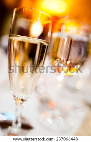An elegant glass of champagne in a new year's eve party - stock photo