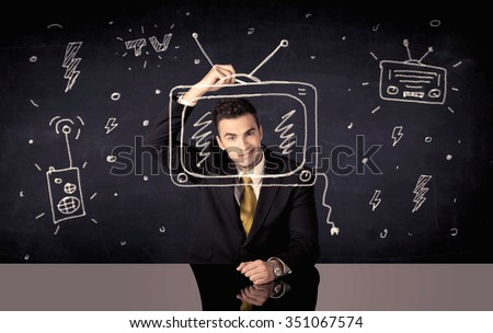 An elegant happy businessman drawing a television around his face, dreaming about becoming a famous actor or a programme presenter concept - stock photo