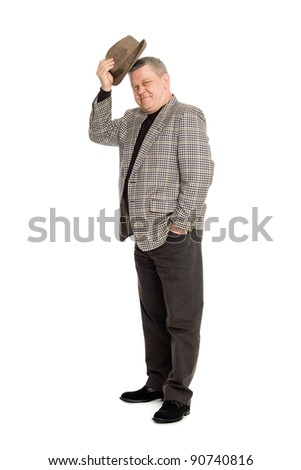 An elegant man in greeting takes off his hat. - stock photo