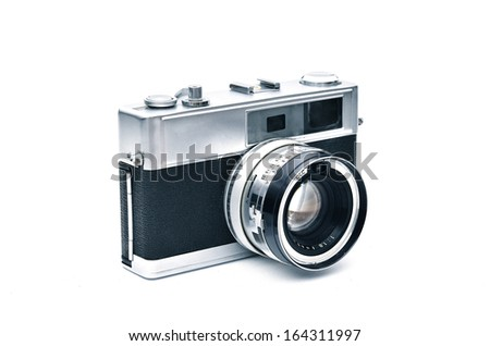 An elegant retro range finder camera isolated in white