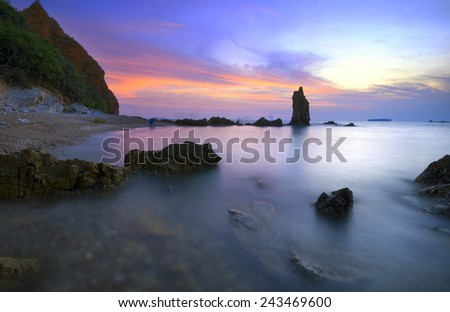 An elegant stone bars stand in bright candy colors beautiful sunset beach . - stock photo