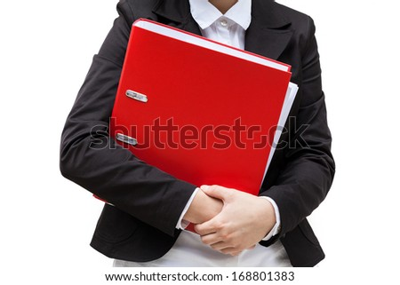 An elegant woman holding a red file binder