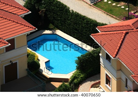 an elevated view of several houses and swimming-pool