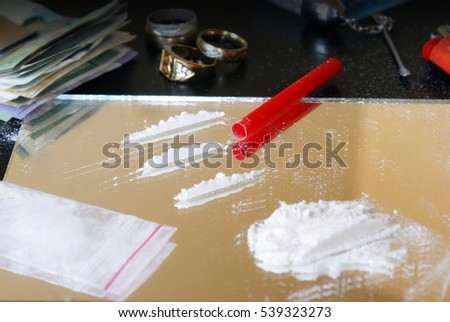 An emphasis image of drug culture focused here on cocaine usage.