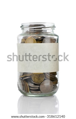 An empt text label on full coins of jar isolated on white background - saving, donation, financial, future investment and insurance concept - stock photo