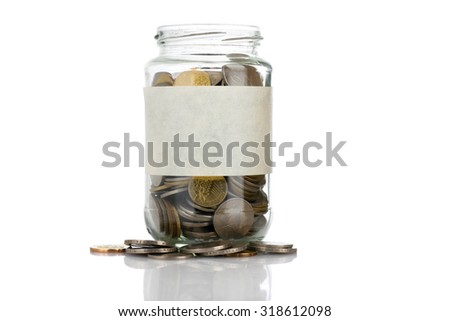An empt text label on full coins of jar spill out from it isolated on white background - saving, donation, financial, future investment and insurance concept - stock photo