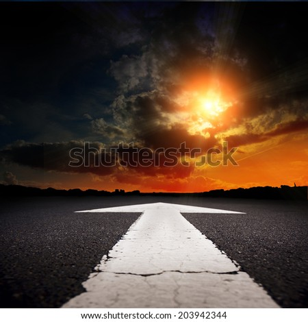 An empty asphalt road at sunset - stock photo
