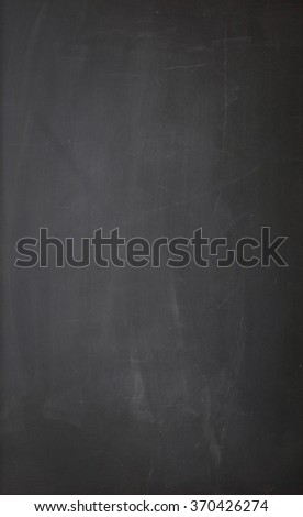 An empty blackboard background. The blackboard has dirty chalk texture. Great use for drawing diagrams, for menus, for business and for educational concepts.  - stock photo
