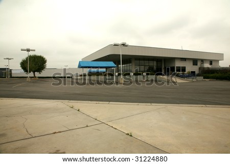 an empty car dealership  state of the economy series - stock photo