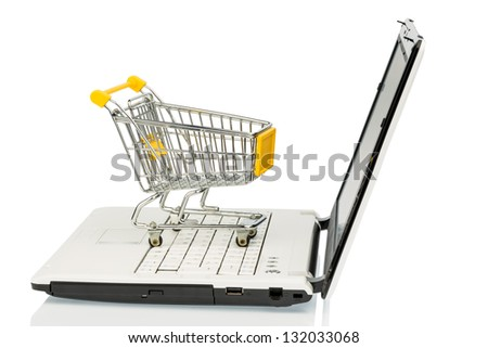 an empty cart on a laptop computer. symbolic photo for internet shopping - stock photo