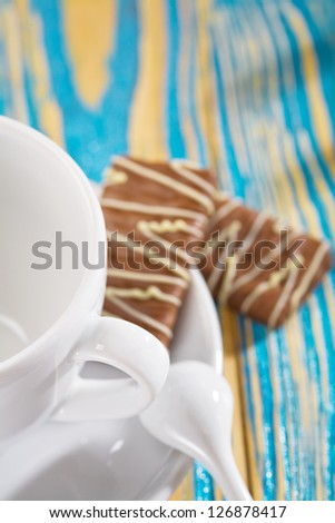 an empty coffe cup(focus on handle of cup)