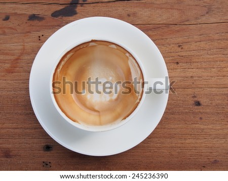 An empty cup of coffee with stains - stock photo