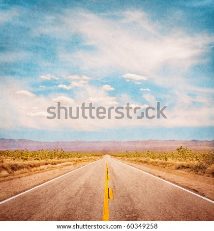 An empty desert road with paper textures and a subtle vignette.