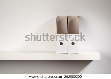 An empty document organizer placed on a shelf. - stock photo