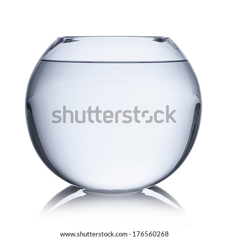 an empty fishbowl filled with water - stock photo