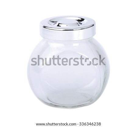 An empty Glass jar for spices on a white background, shallow DOF - stock photo