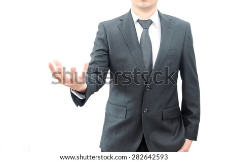 An empty hand of a businessman in suit