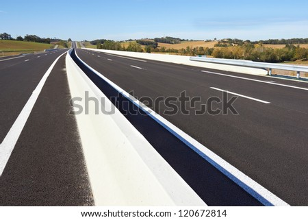 An empty Highway in a sunny day