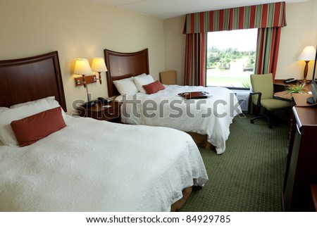 An empty hotel or motel room with two beds