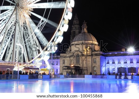 An empty Ice rink and winterwonderland Cardiff. City Hall in background. - stock photo