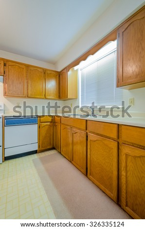 An empty kitchen in a house. - stock photo