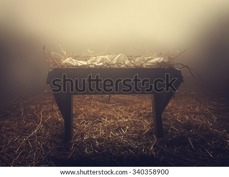 An empty manger at night under foggy conditions - stock photo