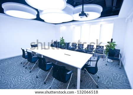 An empty meeting room and conference table - stock photo
