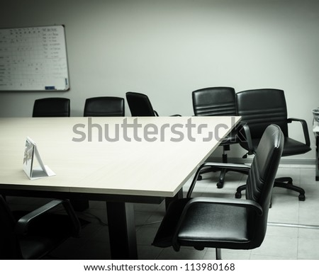 An empty meeting room and conference table, from mirror sticker - stock photo