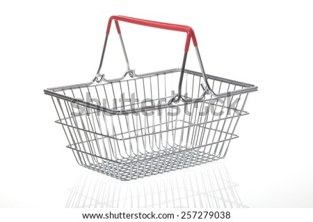 An empty metal shopping supermarket trolley basket on a white background  - stock photo