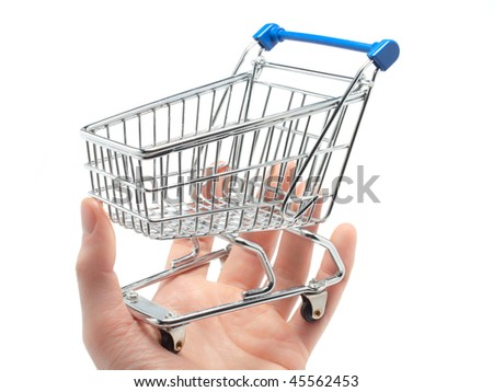 An empty miniature shopping cart held in the palm of a man's hand - stock photo