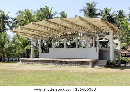An empty outdoor stage in the park - stock photo