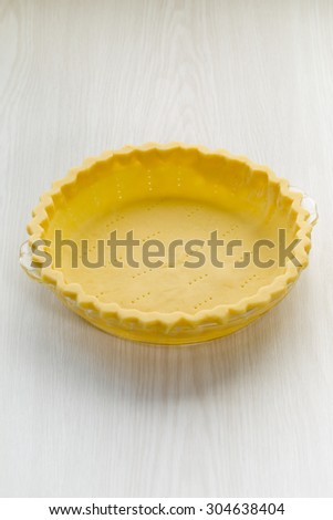 An empty pie crust just waiting to be filled with a delicious filling. A simple photo for many applications for bakeries, restaurants, chefs, cooking magazines, flour companies, or many other ideas.  - stock photo