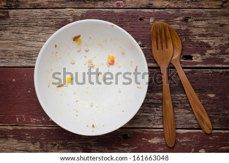 An empty plate, dirty after the meal is finished. View from above. - stock photo
