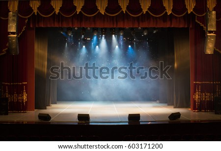 An Empty Stage Of The Theater Lit By Spotlights And Smoke Before Performance