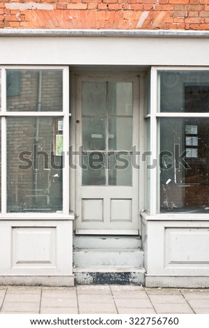 An empty store with glass windows and door in a UK town - stock photo