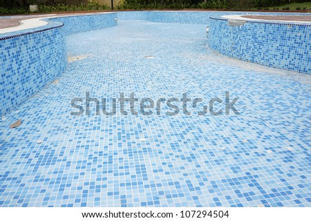 An empty swimming pool under construction. - stock photo