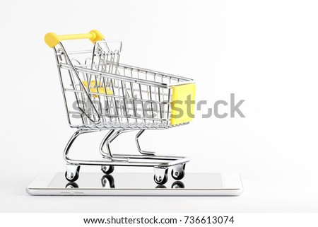 An empty trolley with a digital tab over white background. Online business or marketing concept.