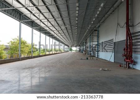 An empty warehouse road way for goods receiving, taken indoor - stock photo