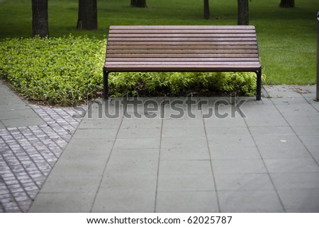 an empty wet park bench