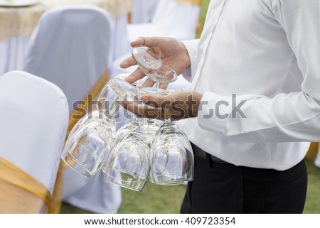 An empty wine glass in hand. - stock photo