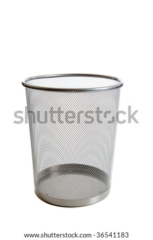 An empty wire mesh trash can on white background with copy space - stock photo