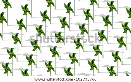An energy producing farm consisting of green toy windmills made out of leaves - stock photo