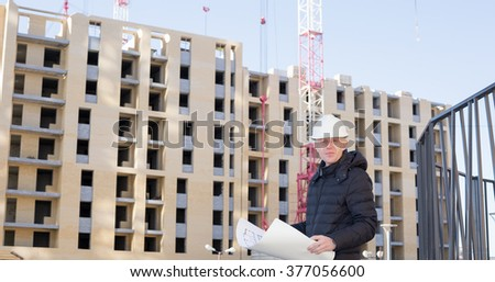 An engineer on a construction site with cranes - stock photo