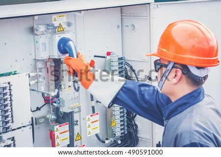 an engineer working on checking equipment in solar power plant