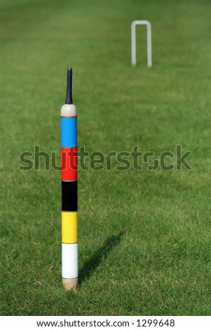 An English croquet lawn, focus on the centre peg - stock photo